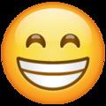 Эмодзи 😁 Сияющее лицо со смеющимися глазами в месседжере WhatsApp