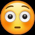 Эмодзи 😳 Смущённый в месседжере WhatsApp